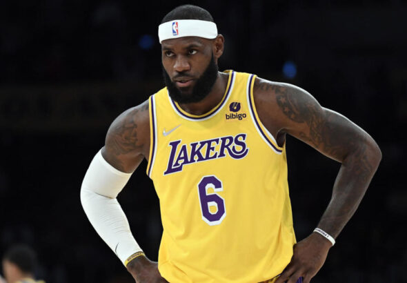 WATCH: Lakers' LeBron James gives game-worn sneakers and towel to young fan in Sacramento
